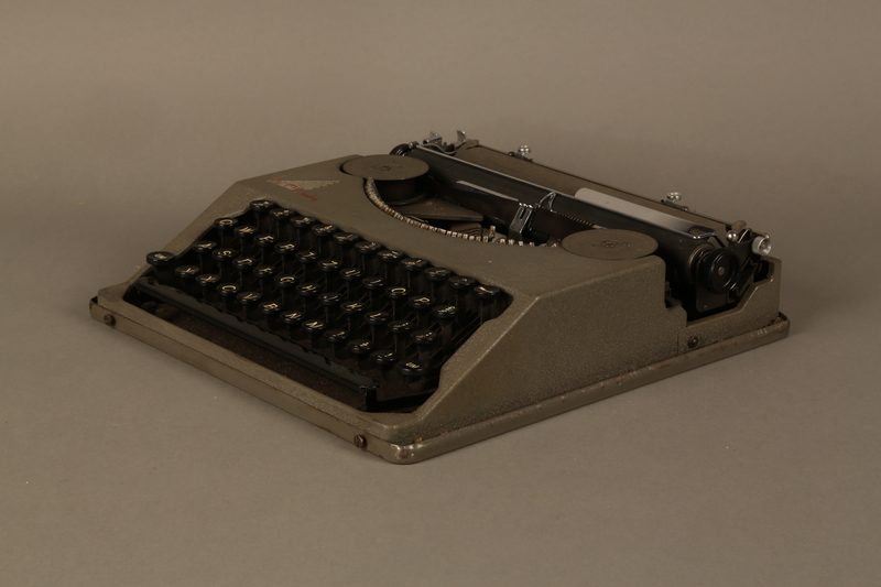 2016.443.2_a 3/4 view Hermes Baby typewriter with lid used by a Jewish refugee