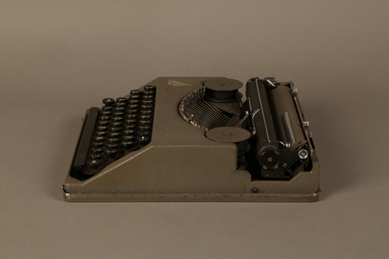2016.443.2_a left side Hermes Baby typewriter with lid used by a Jewish refugee