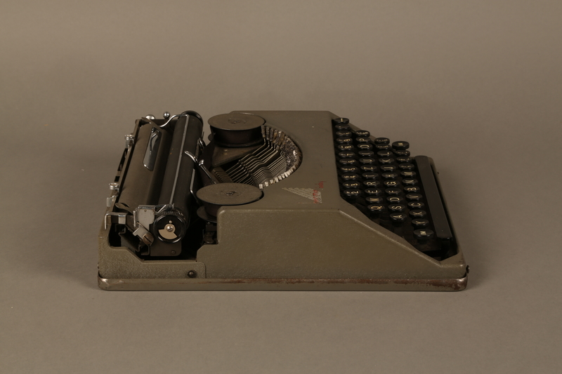 2016.443.2_a right side Hermes Baby typewriter with lid used by a Jewish refugee