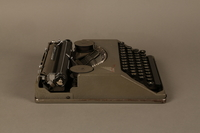 2016.443.2_a right side Hermes Baby typewriter with lid used by a Jewish refugee  Click to enlarge