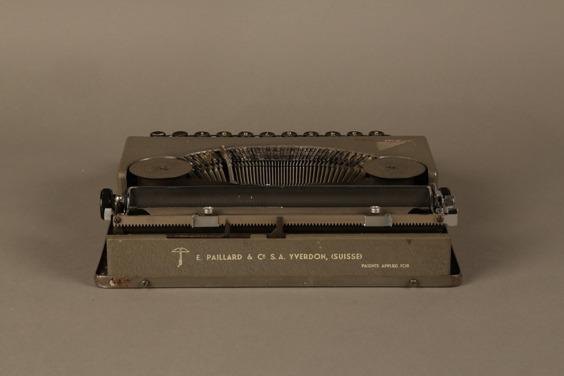 2016.443.2_a back Hermes Baby typewriter with lid used by a Jewish refugee