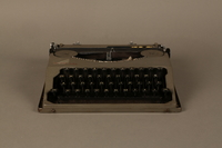 2016.443.2_a front Hermes Baby typewriter with lid used by a Jewish refugee  Click to enlarge