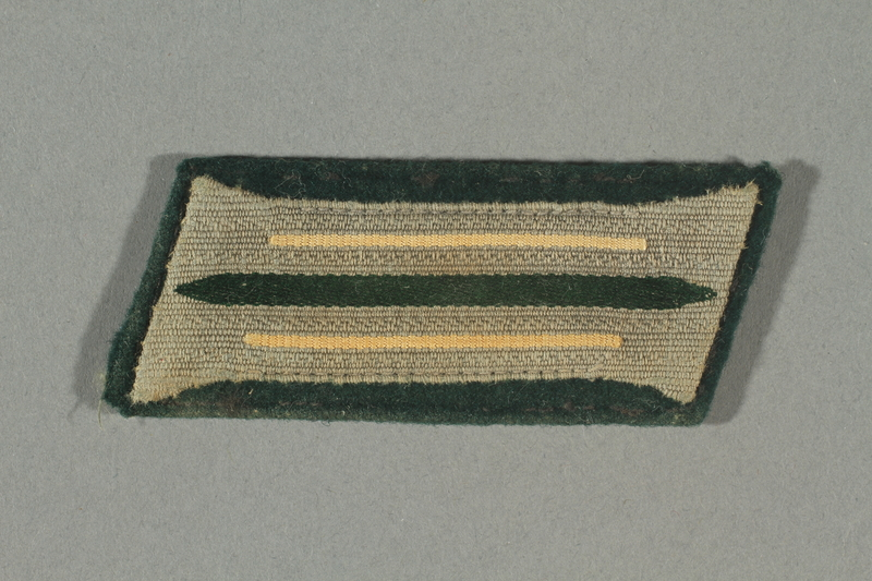 2016.457.6 front Collar tab acquired by an American soldier