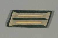 2016.457.6 front Collar tab acquired by an American soldier  Click to enlarge