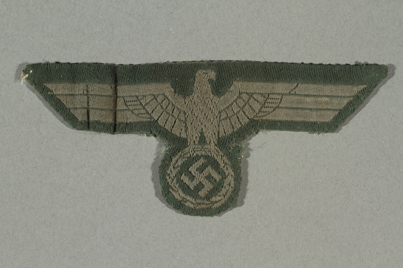 2016.457.7 front Patch with an eagle insignia belonging to an American soldier