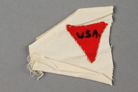 2016.468.2 front Red triangle patch embroidered USA worn by an American concentration camp inmate  Click to enlarge