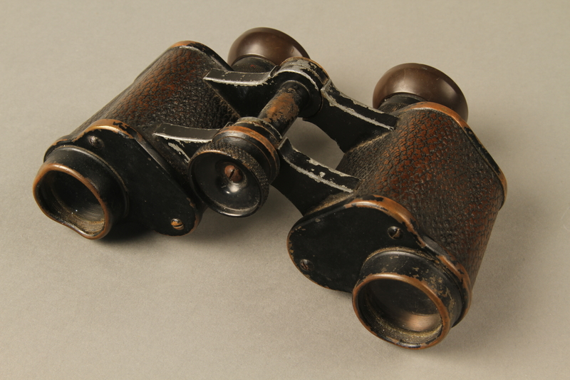 2016.471.5 3/4 view top Binoculars thrown at US soldier during concentration camp liberation