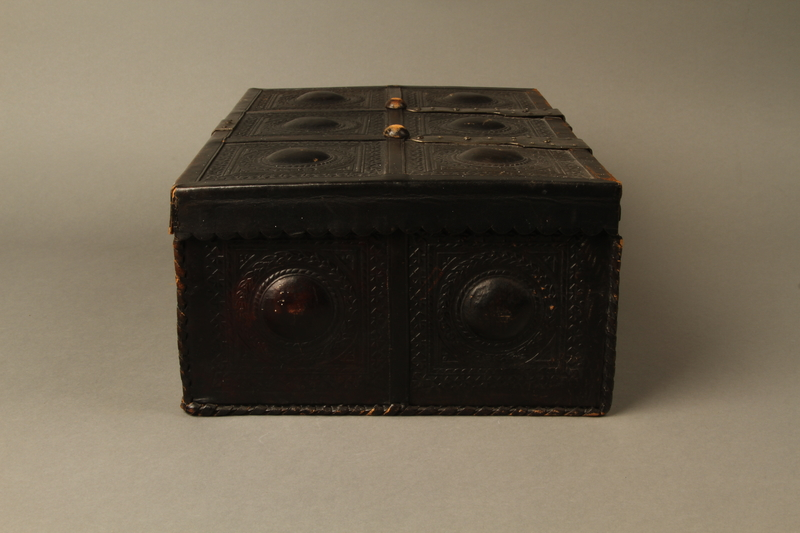 2015.600.2 left Leather and metal box owned by German Jewish refugees
