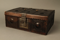 2015.600.2 3/4 view Leather and metal box owned by German Jewish refugees  Click to enlarge
