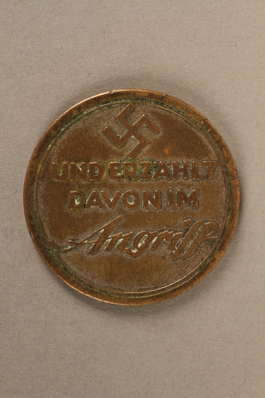 2017.210.1 front Souvenir coin with a swastika and Star of David