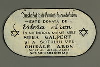 2016.486.1 side B Painted metal plaque memorializing Romanian Jews killed in the Holocaust  Click to enlarge