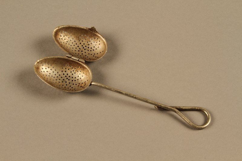2014.490.7 open Tea infuser spoon owned by a Romanian Jewish family