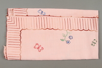 2014.490.10 side a Embroidered pink tablecloth with a floral design owned by a Romanian Jewish woman  Click to enlarge
