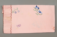 2014.490.10 side b Embroidered pink tablecloth with a floral design owned by a Romanian Jewish woman  Click to enlarge