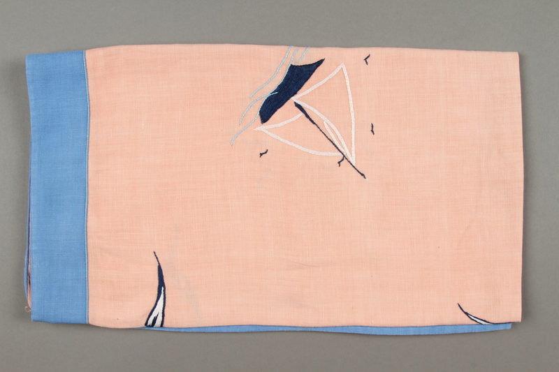 2014.490.11 side a Embroidered pink tablecloth with a nautical design owned by a Romanian Jewish woman