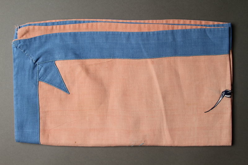 2014.490.11 side b Embroidered pink tablecloth with a nautical design owned by a Romanian Jewish woman