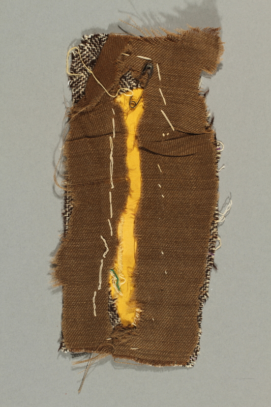 2016.496.2 back Yellow, rectangular patch on cloth backing worn by a German Jewish woman in a concentration camp
