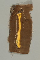 2016.496.2 back Yellow, rectangular patch on cloth backing worn by a German Jewish woman in a concentration camp  Click to enlarge