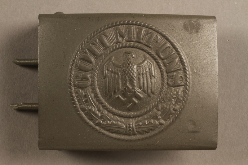 2017.179.3 front Nazi painted belt buckle given to US internee camp commander by German prisoner