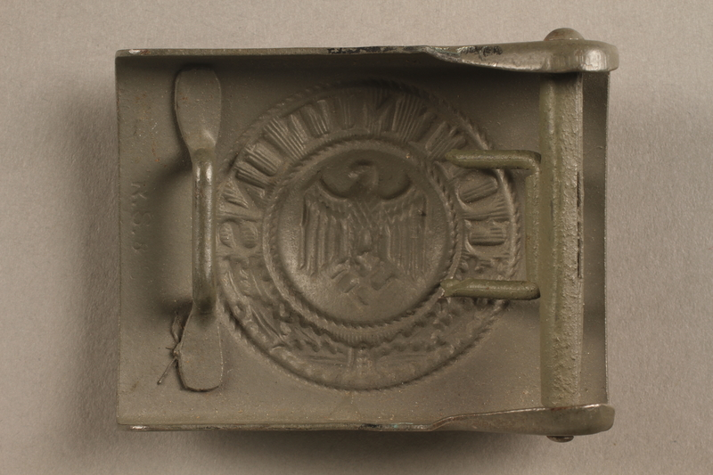 2017.179.3 back Nazi painted belt buckle given to US internee camp commander by German prisoner