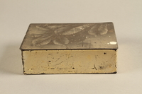 2017.179.4 front Box with embossed foliage given to US internee camp commander by German prisoner  Click to enlarge