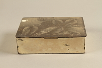 2017.179.4 back Box with embossed foliage given to US internee camp commander by German prisoner  Click to enlarge