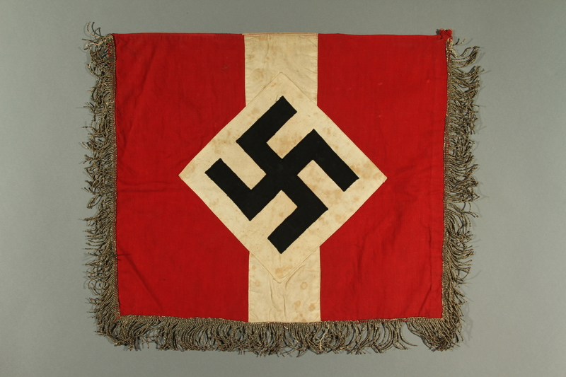2017.179.6 side A Metallic fringed Nazi flag given to US internee camp commander by German prisoner