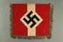 Metallic fringed Nazi flag given to US internee camp commander by German prisoner