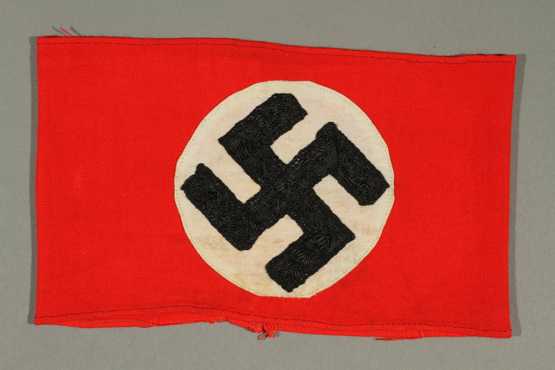 2012.427.7 front Red armband with swastika acquired by American soldier and liberator