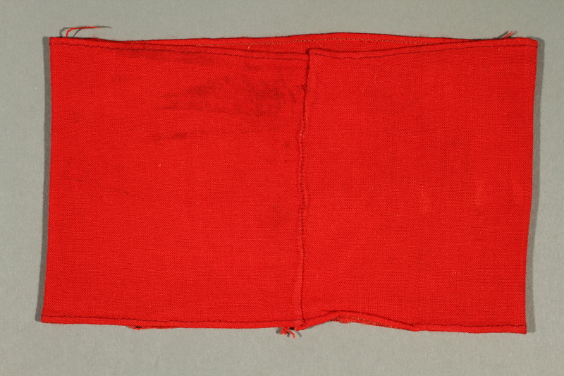 2012.427.7 back Red armband with swastika acquired by American soldier and liberator