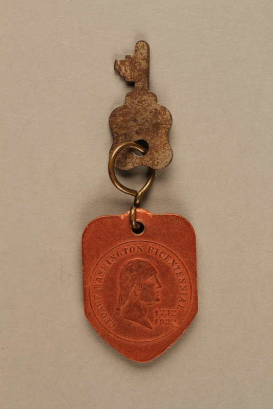 2017.397.1 front Key fob commemorating the bicentennial of George Washington's birth with a swastika on the back