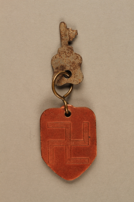 2017.397.1 back Key fob commemorating the bicentennial of George Washington's birth with a swastika on the back