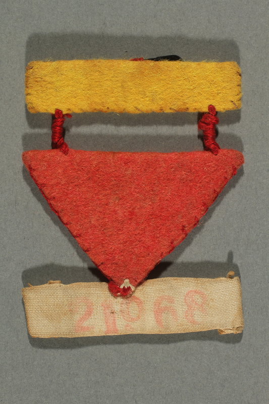 2017.193.3 front Three part badge with number 21968 worn by a German Jewish forced laborer
