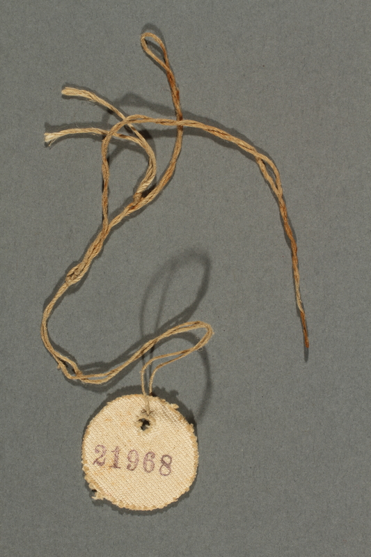2017.193.4 side B Circular badge with number 21968 worn by a German Jewish forced laborer