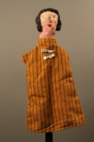 2017.213.8 front Hand puppet of a woman created by a German Jewish Holocaust survivor and World War II veteran  Click to enlarge