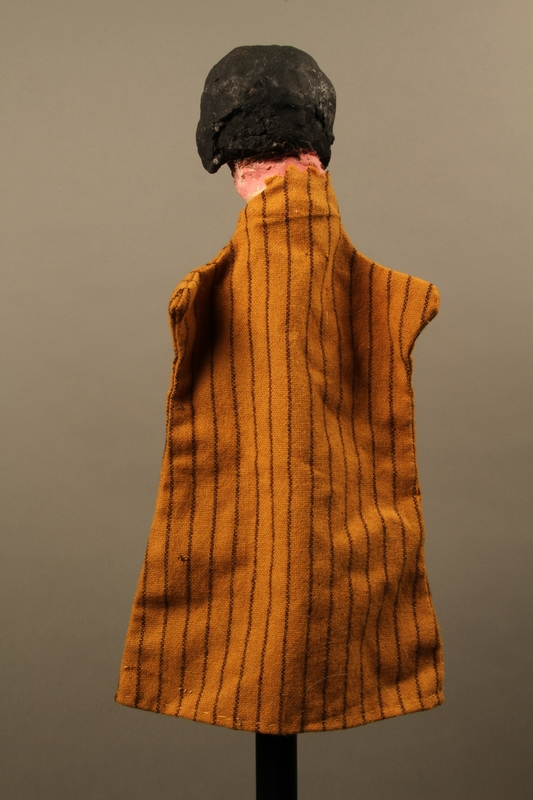 2017.213.8 back Hand puppet of a woman created by a German Jewish Holocaust survivor and World War II veteran