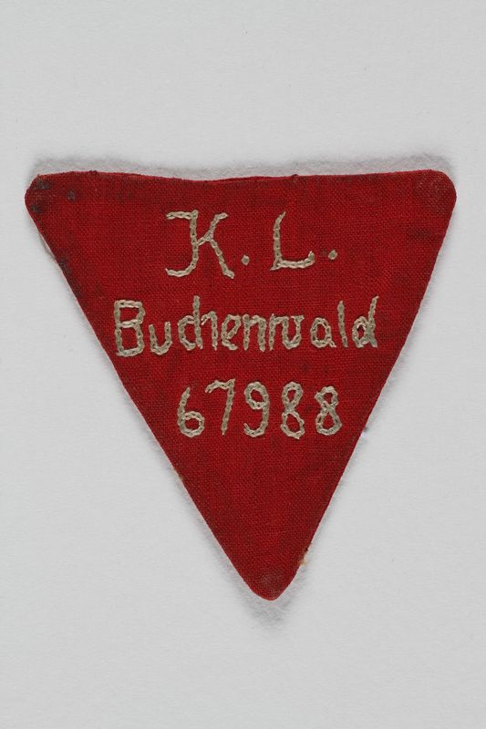 1991.88.1 front Red triangle prisoner badge 67988 from Buchenwald