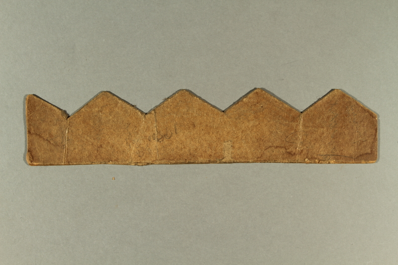 2006.511.5  back Peaked cutting template brought with an Austrian Jewish refugee
