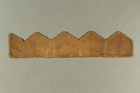 2006.511.5  back Peaked cutting template brought with an Austrian Jewish refugee  Click to enlarge