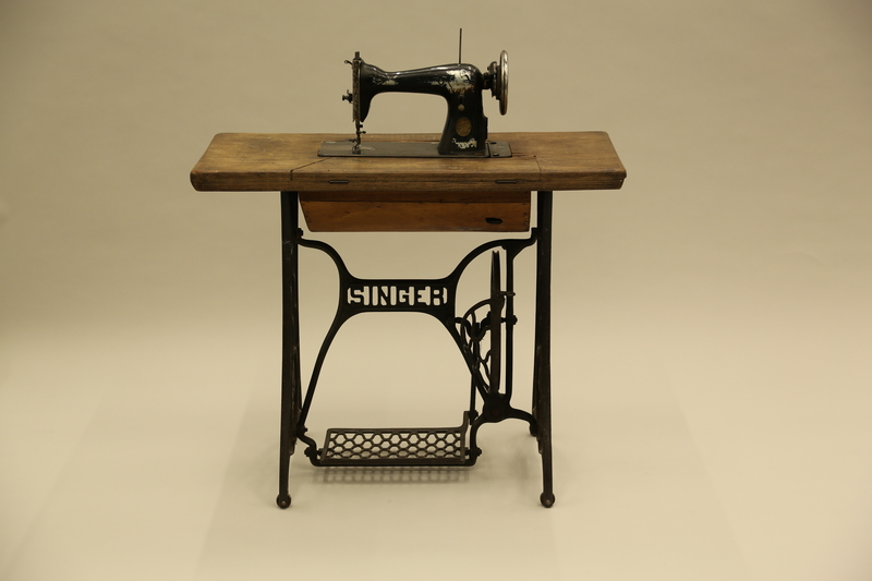 2017.218.1_a-d front Singer Model 15 sewing machine and table used by Jewish Romanian woman who was massacred