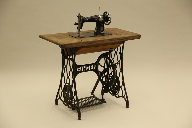 2017.218.1_a-d 3/4 view Singer Model 15 sewing machine and table used by Jewish Romanian woman who was massacred