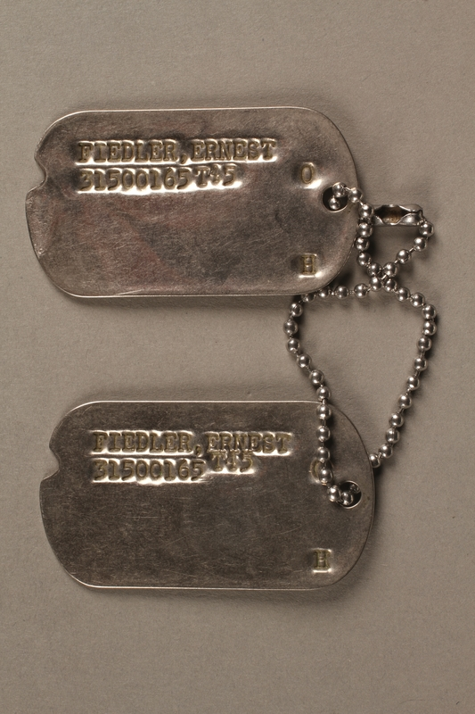 2017.219.2 front US military ID tags issued to German refugee and soldier in Counterintelligence Corps