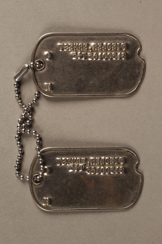 2017.219.2 back US military ID tags issued to German refugee and soldier in Counterintelligence Corps