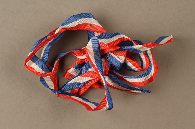 2017.362.6 front Red white and blue ribbon with the ends tied together given to former Vice President Henry A. Wallace by female French partisans