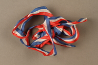 2017.362.6 front Red white and blue ribbon with the ends tied together given to former Vice President Henry A. Wallace by female French partisans  Click to enlarge