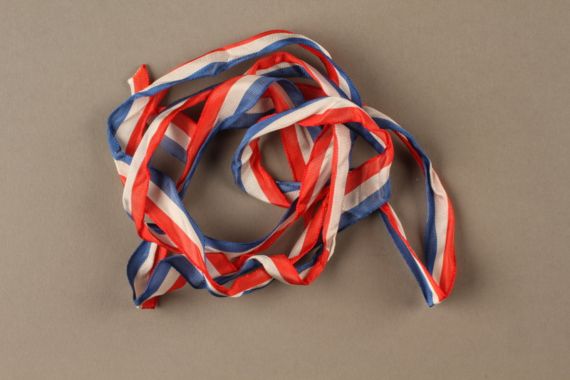 2017.362.5 front Red, white and blue ribbon given to former Vice President Henry A. Wallace by female French partisans