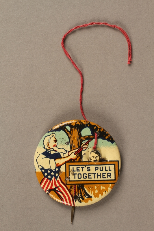 2003.195.2 string pulled Let's Pull Together anti-Hitler mechanical lapel pin
