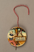 2003.195.2 string pulled Let's Pull Together anti-Hitler mechanical lapel pin  Click to enlarge