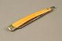 Straight razor with yellow plastic handle