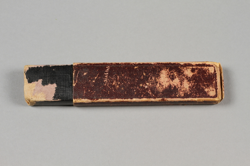 2017.263.6 b back Straight razor with yellow plastic handle
